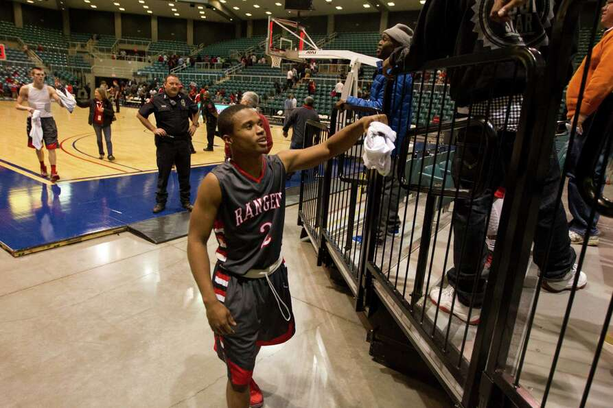 Terry guard Eugene Wright (2) celebrates after defeating Crosby 66-49 during the 4A Region III tourn