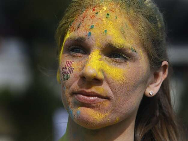 Melanie Caetano is multi-colored after completing the Color Run 5K run at Candlestick Park in San Francisco, Calif. on Saturday, March 2, 2013. Photo: Paul Chinn, The Chronicle