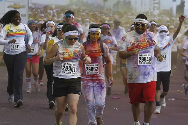 Runners participate in the Color Run 5K run at Candlestick Park in San Francisco, Calif. on Saturday, March 2, 2013. Photo: Paul Chinn, The Chronicle