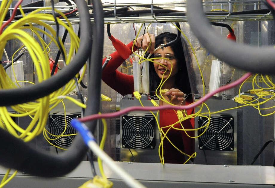 Materials engineer Ayesha Gonsalves works in the battery testing lab at GE Global Research on Friday March 1, 2013 in Niskayuna, N.Y.  (Lori Van Buren / Times Union) Photo: Lori Van Buren