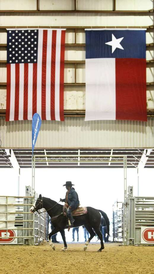 Carol Seals warms up her quarter horse named Cowboy for the grand entry of the Black Professional Cowboys & Cowgirls Association's 14th annual Heritage Day rodeo, Saturday, March 2, 2013, at the Humble Civic Arena in Humble. Photo: Nick De La Torre, Chronicle / © 2013 Houston Chronicle