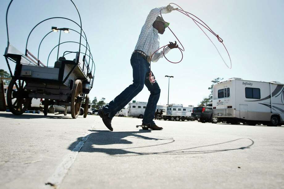 Levar Anderson, 16, of Houston, practices roping a steer with other teenagers during the Black Professional Cowboys & Cowgirls Association's 14th annual Heritage Day, Saturday, March 2, 2013, at the Humble Civic Arena in Humble. Photo: Nick De La Torre, Chronicle / © 2013 Houston Chronicle