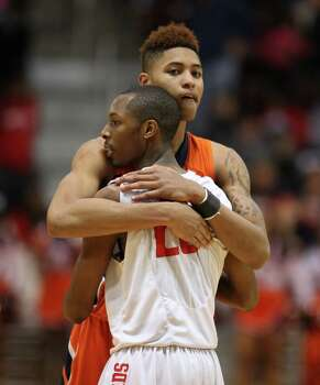 Bush 66, Bellaire 59Bellaire's Darin Minniefield (23) hugs Bush's Kelly Oubre after the Cardinals lost to the Broncos. Photo: Eric Christian Smith, For The Chronicle