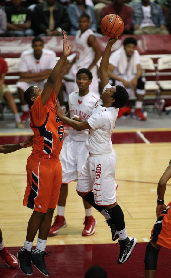 Bellaire's Calvin Dean (rig hush's Ladarius Johnson during the second half of a 5A Region III high school playoff basketball game, Friday, March 1, 2013 at the Campbell Center in Houston, TX. (Photo: Eric Christian Smith/For the Houston Chronicle) Photo: Eric Christian Smith, For The Chronicle
