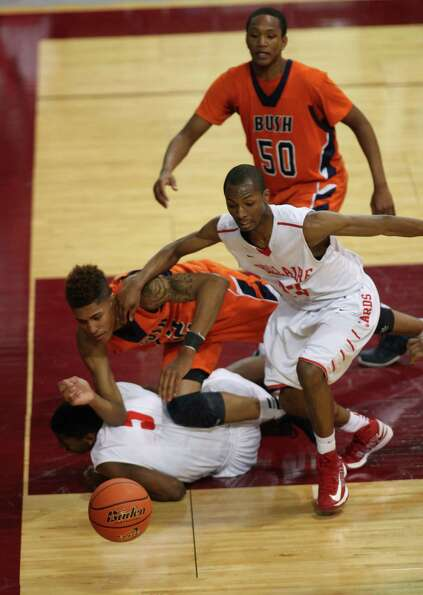 Bellaire's Ryheem Malone (13) chases past Bush's Kelly Oubre for a loose ball during the second half