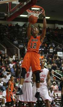 Bush's Kelly Oubre (12) dunks the ball for two points during the first half of a 5A Region III high school playoff basketball game against Bellaire, Friday, March 1, 2013 at the Campbell Center in Houston, TX. (Photo: Eric Christian Smith/For the Houston Chronicle) Photo: Eric Christian Smith, For The Chronicle