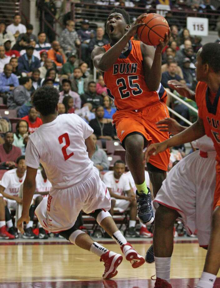 Bush's Brandon Jones (25) drives to the basket past Bellaire's Alan Long during the first half of a 5A Region III high school playoff basketball game, Friday, March 1, 2013 at the Campbell Center in Houston, TX. (Photo: Eric Christian Smith/For the Houston Chronicle) Photo: Eric Christian Smith, For The Chronicle