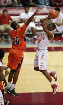 Bellaire's Darin Minniefield (right) shoots over Bush's Ladarius Johnson during the second half of a 5A Region III high school playoff basketball game, Friday, March 1, 2013 at the Campbell Center in Houston, TX. (Photo: Eric Christian Smith/For the Houston Chronicle Photo: Eric Christian Smith, For The Chronicle