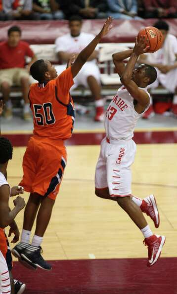 Bellaire's Darin Minniefield (right) shoots over Bush's Ladarius Johnson during the second half of a