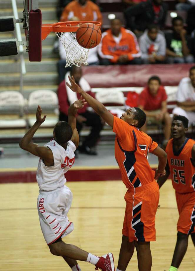 Bellaire's Darin Minniefield (left) has his shot blocked by Bush's Ladarius Johnson during the second half of a 5A Region III high school playoff basketball game, Friday, March 1, 2013 at the Campbell Center in Houston, TX. (Photo: Eric Christian Smith/For the Houston Chronicle) Photo: Eric Christian Smith, For The Chronicle