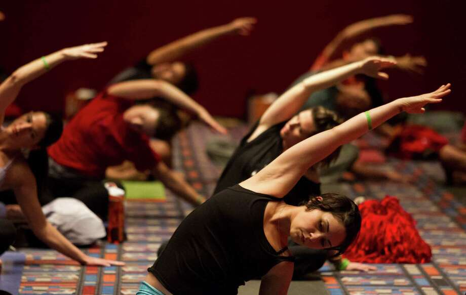 Participants perform yoga techniques during the 2013 Yoga Conference held at the George R. Brown Convention Center on Saturday, March 2, 2013, in Houston. Photo: J. Patric Schneider, For The Chronicle / © 2013 Houston Chronicle