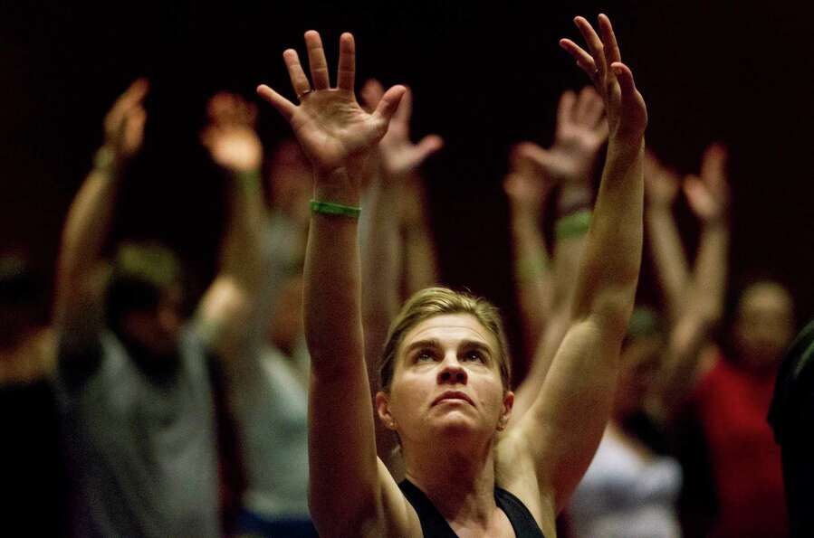 Laura Trachtman performs yoga techniques during the 2013 Yoga Conference held at the George R. Brown