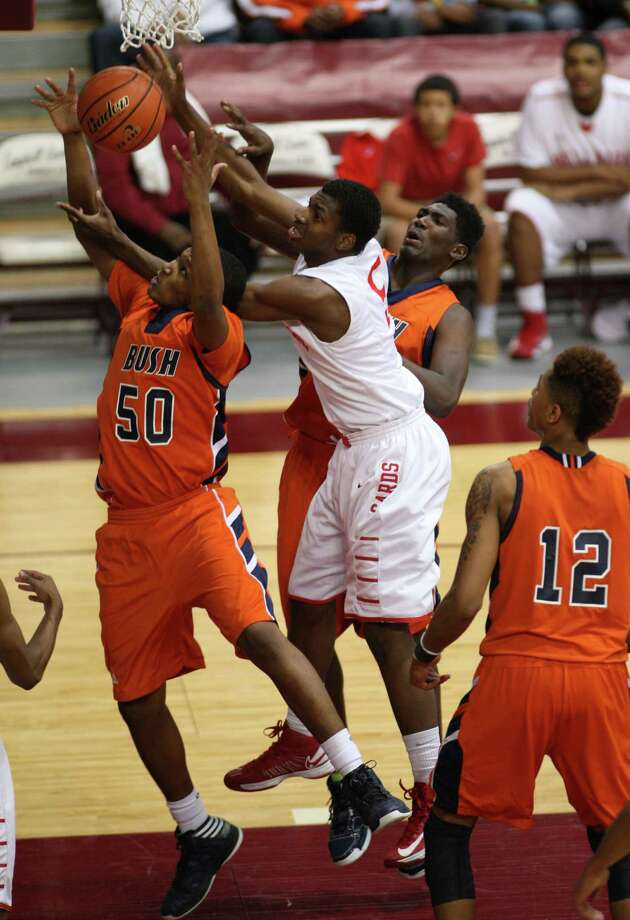 Bush's Ladarius Johnson (left) fights for a rebound with Bellaire's Cruz Ginns, Jr. during the second half. Photo: Eric Christian Smith, For The Chronicle