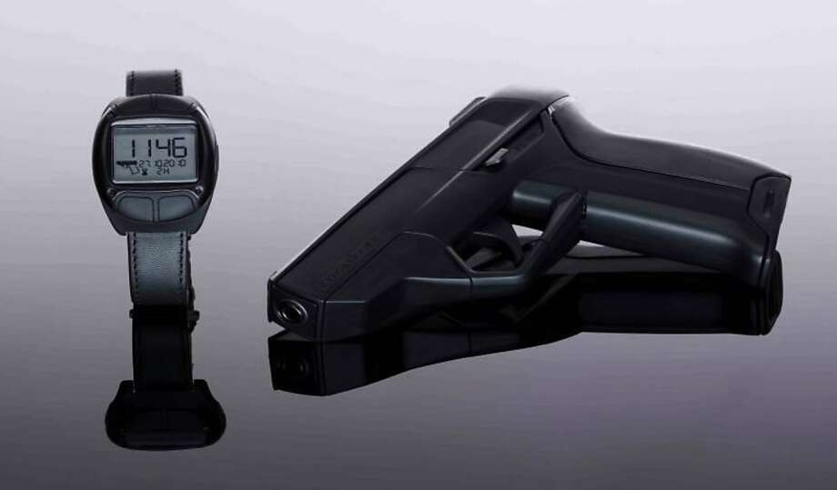 A German company, Armatix, says it will begin selling a pistol this year in the U.S. that will only fire after the owner enters a five-digit code into a watch. Photo: Courtesy Armatix