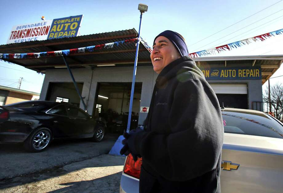 Anna Vasquez fills in answering phones at her brother David Vasquez's auto shop on N. WW White on Feb. 19, 2013, while he is out of town.  She was given permission to be there by her parole officer until they realized the property backed up to a school property line. There aren't many places she is allowed to go. Photo: Bob Owen, San Antonio Express-News / © 2012 San Antonio Express-News