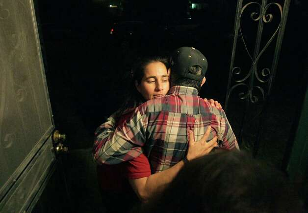 Anna Vasquez gives her father Jesse Vasquez a hug as he leaves after celebrating Thanksgiving with family members at her Anna's mother's house, her first after being released on parole, Thursday, Nov. 22, 2012. Photo: Bob Owen, San Antonio Express-News / © 2012 San Antonio Express-News