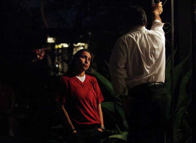 Anna Vasquez talks with her brother Jerry Vasquez on their mother's front porch after they celebrated her first Thanksgivings after being released on parole, Thursday, Nov. 22, 2012. Photo: Bob Owen, San Antonio Express-News / © 2012 San Antonio Express-News