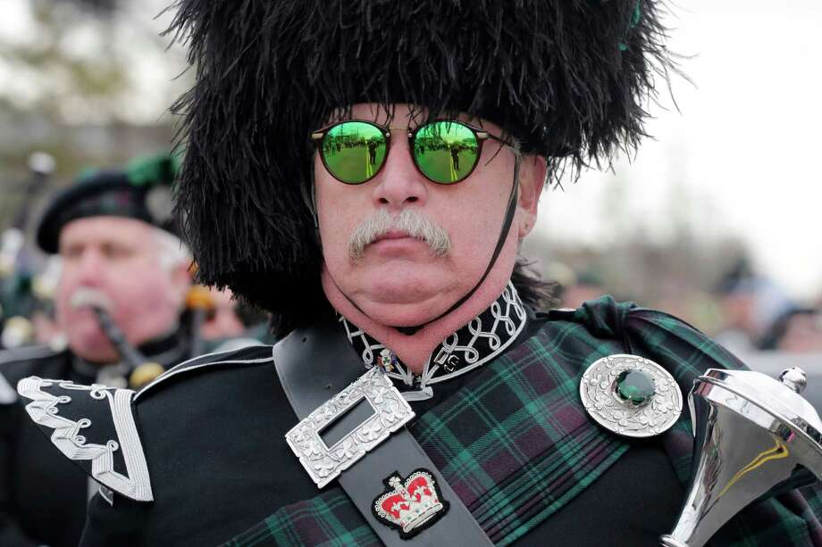 A drum major leads a bagpipe marching band during the Queens County St. Patrick's Day Parade in the Rockaway section of New York, Saturday, March 2, 2013. Photo: Mark Lennihan, Associated Press / AP