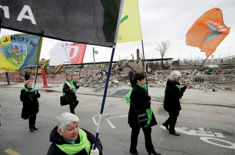 Marie Lopresti, left foreground, and friends from the Breezy Point section of New York march in the Queens County St. Patrick's Day Parade in the Rockaways, Saturday, March 2, 2013. Photo: Mark Lennihan, Associated Press / AP