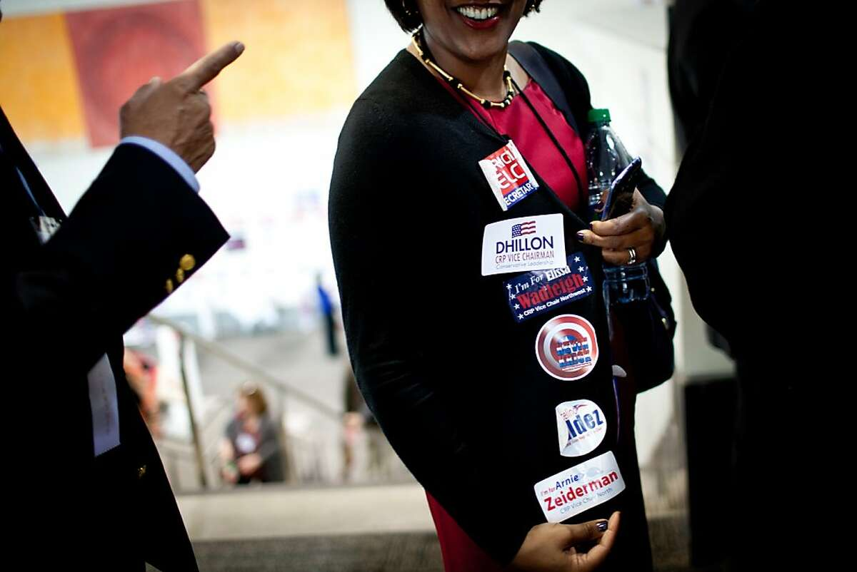 Sashi McEntee of Marin display her favorites for party office in the California Republican Party at their convention, March 2, 2013 in Sacramento, California.