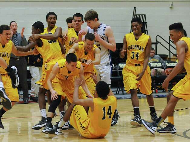 The Brennan Bears celebrate their overtime victory over the Alamo Heights Mules in the Region iV-4A final at Littleton Gym on Saturday, March 2, 2013. Photo: Billy Calzada, Express-News / San Antonio Express-News