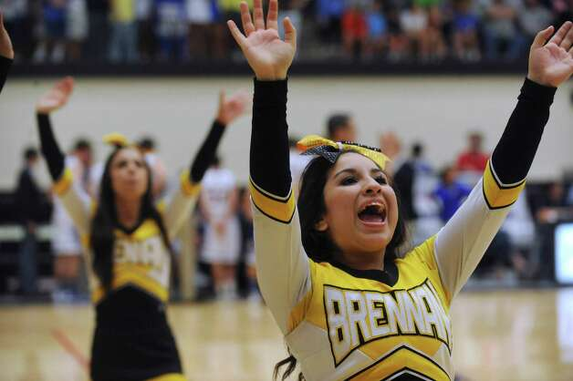Brennan cheerleaders encourage the crowd during the boys basketball Region iV-4A final against Alamo Heights at Littleton Gym on Saturday, March 2, 2013. Photo: Billy Calzada, Express-News / San Antonio Express-News