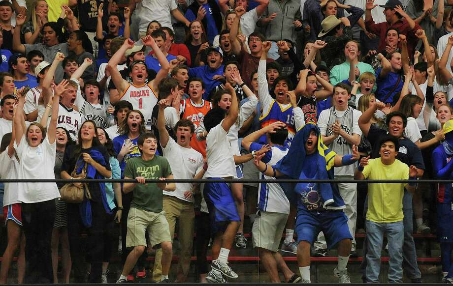 Alamo Heights fans celebrate after guard David Favorite scored on a last-second three point shot to send the Region iV-4A final against Brennan into overtime at Littleton Gym on Saturday, March 2, 2013. Photo: Billy Calzada, Express-News / San Antonio Express-News