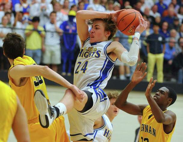 Max Riemenschneider of Alamo Heights pulls down an offensive rebound during the boys basketball Region iV-4A final at Littleton Gym on Saturday, March 2, 2013. Photo: Billy Calzada, Express-News / San Antonio Express-News