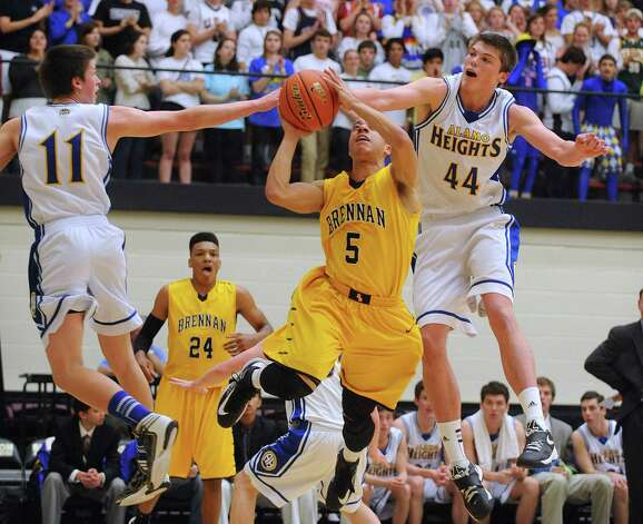 David Favorite, left, and Ben Lammers (44) of Alamo Heights attempt to defend as John Azzinaro of Brennan shoots during the boys basketball Region iV-4A final at Littleton Gym on Saturday, March 2, 2013. Photo: Billy Calzada, Express-News / San Antonio Express-News