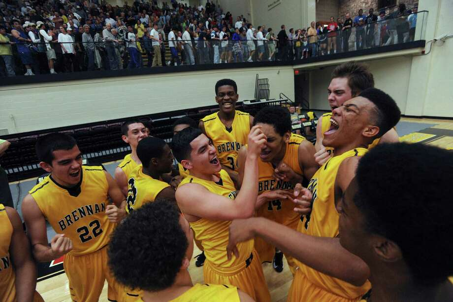 The Brennan Bears celebrate after defeating Alamo Heights in the Region iV-4A final at Littleton Gym on Saturday, March 2, 2013. Photo: Billy Calzada, Express-News / San Antonio Express-News