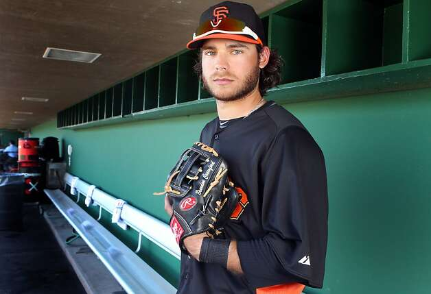 The Giants' Brandon Crawford says it's time for a new glove despite a nice year with the last one. Photo: Lance Iversen, The Chronicle