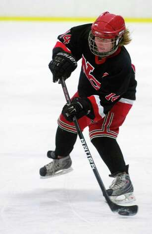 New Canaan's Madzie Carroll takes a shot during Saturday's girls hockey state championship game against Hall-Conard at Terry Connors Rink in Stamford, Conn., on March 2, 2013. Photo: Lindsay Perry / Stamford Advocate