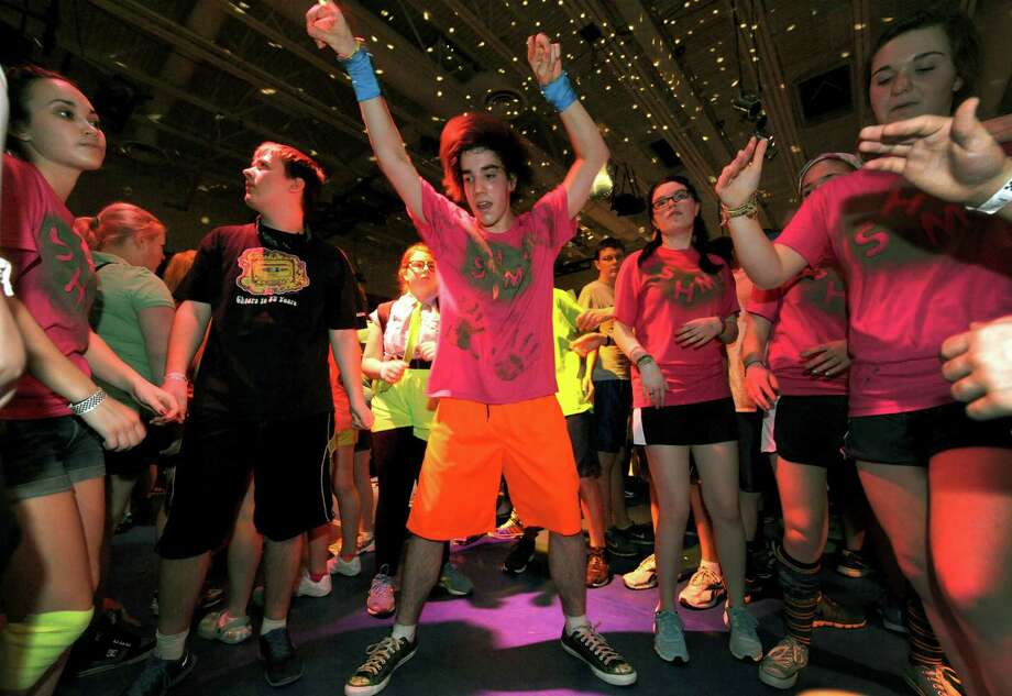 South Glens Falls junior James Greene, center, joins other students dancing during the 36th annual South Glens Falls H.S. Dance Marathon on Saturday March 2, 2013 in South Glens Falls, N.Y. 800 students busted a move to raise money for people from the community who are in need, mostly because of illness. (Michael P. Farrell/Times Union) Photo: Michael P. Farrell