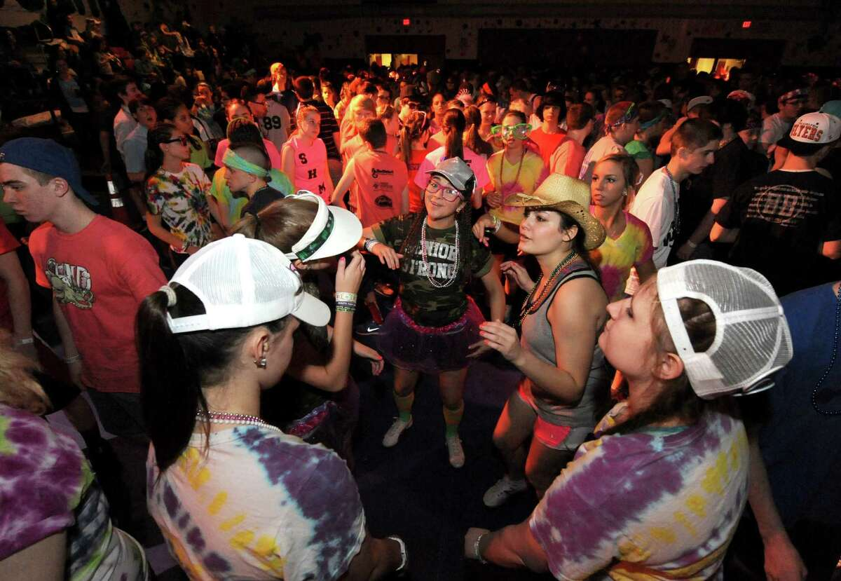 South Glens Falls senior Rachel Bean, center, joins other students dancing during the 36th annual South Glens Falls H.S. Dance Marathon on Saturday March 2, 2013 in South Glens Falls, N.Y. 800 students busted a move to raise money for people from the community who are in need, mostly because of illness. (Michael P. Farrell/Times Union)