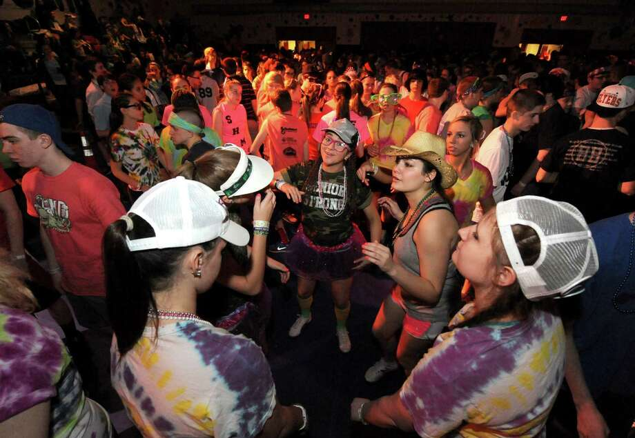 South Glens Falls senior Rachel Bean, center, joins other students dancing during the 36th annual South Glens Falls H.S. Dance Marathon on Saturday March 2, 2013 in South Glens Falls, N.Y. 800 students busted a move to raise money for people from the community who are in need, mostly because of illness. (Michael P. Farrell/Times Union) Photo: Michael P. Farrell