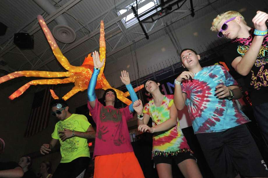 South Glens Falls High School students dancing during the 36th annual South Glens Falls H.S. Dance Marathon on Saturday March 2, 2013 in South Glens Falls, N.Y. 800 students busted a move to raise money for people from the community who are in need, mostly because of illness. (Michael P. Farrell/Times Union) Photo: Michael P. Farrell