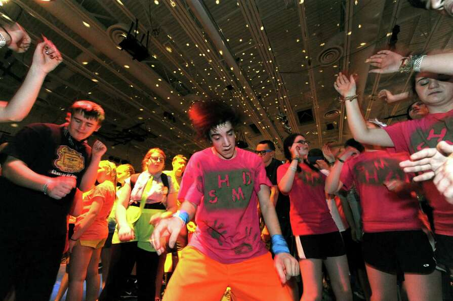 South Glens Falls junior James Greene, center, joins other students dancing during the 36th annua