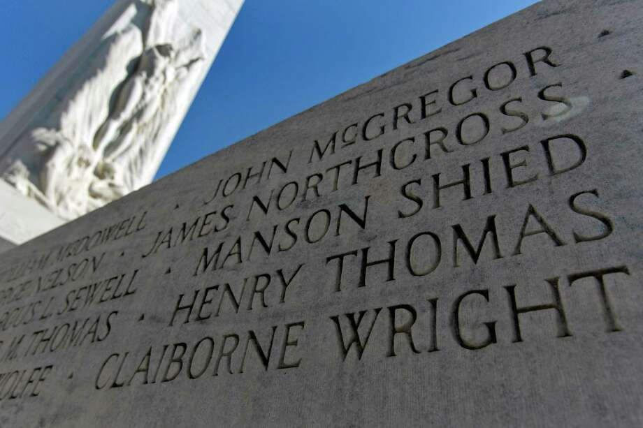 Claiborne Wright's name is carved last on the Alamo cenotaph, but the stonecutter - for unknown reasons - left one name off: Danish native Charles Zanco. Photo: William Luther, Staff / © 2013 San Antonio Express-News