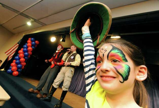 Darby Dunsmore, 8, of Rotterdam assists Ringling Brothers Circus clowns during the Hannaford Kidz Expo at the Empire State Plaza on Saturday March 2, 2013 in Albany, N.Y. (Michael P. Farrell/Times Union) Photo: Michael P. Farrell