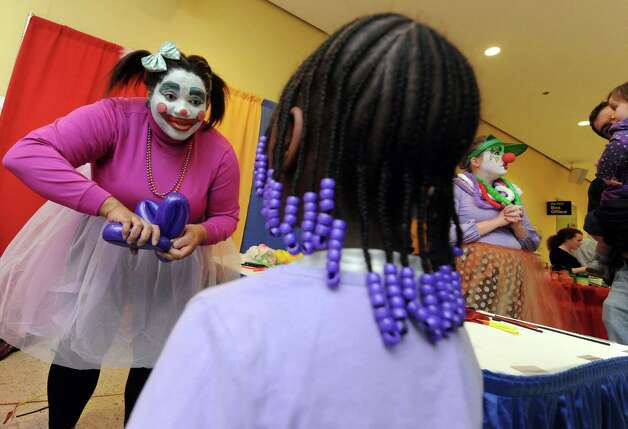 Nicole Dama of Albany plays CoCo the clown while making balloon animals for children during the Hannaford Kidz Expo at the Empire State Plaza on Saturday March 2, 2013 in Albany, N.Y. (Michael P. Farrell/Times Union) Photo: Michael P. Farrell