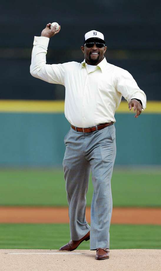 Retired Baltimore Ravens linebacker Ray Lewis throws the first pitch before a baseball spring training exhibition game between the Detroit Tigers and the Pittsburgh Pirates, Saturday, March 2, 2013, in Lakeland, Fla. (AP Photo/Charlie Neibergall) Photo: Charlie Neibergall, Associated Press / AP