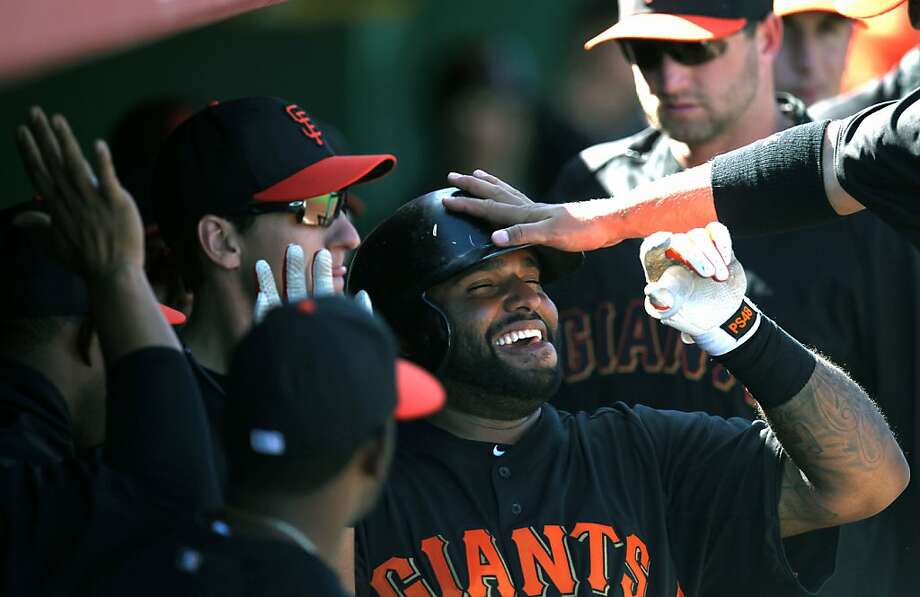 Pablo Sandoval is greeted by teammates after hitting his first spring home run in his final at-bat before leaving for the WBC. Photo: Lance Iversen, The Chronicle