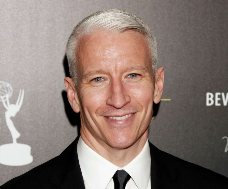 FILE - This June 23, 2012 file photo shows CNN's Anderson Cooper arrives at the 39th Annual Daytime Emmy Awards at the Beverly Hilton Hotel in Beverly Hills, Calif.  The gay advocacy group GLAAD says Madonna will present CNN's Anderson Cooper with an award for openly gay media professionals. GLAAD announced Saturday, Sept. 2, 2013,  that Cooper will receive its Vito Russo Award at the 24th Annual GLAAD Media Awards in New York City on March 16.(Photo by Todd Williamson/Invision/AP, file) Photo: Todd Williamson