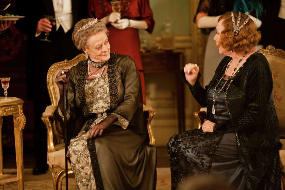 "This undated publicity photo provided by PBS shows Maggie Smith as the Dowager Countess, left, and Shirley MacLaine as Martha Levinson from the TV series, ""Downton Abbey."" Carnival Films and MASTERPIECE on PBS today announced that six new cast names are joining the series plus the return of Shirley MacLaine for next season's finale.  The Hollywood star, who reprises her role as Martha Levinson, proved a huge hit with viewers last year.  (AP Photo/PBS, Carnival Film & Television Limited 2012 for MASTERPIECE, Nick Briggs) Photo: Nick Briggs"
