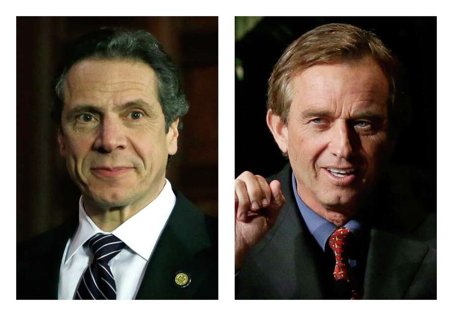 These 2013 file photos show New York Gov. Andrew Cuomo, left, in Albany, N.Y. and Robert F. Kennedy Jr. in Dallas, Texas. People familiar with Cuomo's thinking on fracking tell The Associated Press he was on the brink of approving the much-debated gas drilling method in February 2013 but held off after discussions with environmentalist and former brother-in-law, Kennedy. (AP Photo/Tony Gutierrez) Photo: Mike Groll, Tony Gutierrez
