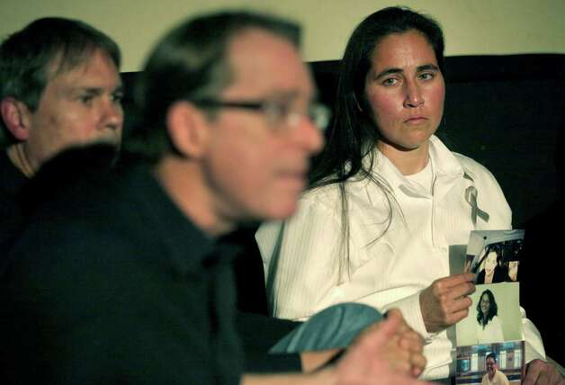 "Anna Vasquez, recently released on parole, listens to lawyer Jeff Blackburn, center, speak at a Work-In-Progress screening of ""San Antonio Four"" a documentary by Deborah S. Esquenazi, about Vasquez and three of her friends, who are still in prison, found guilty of sexual assault of two minors. Thursday, Nov. 15, 2012.  Mike Ware, left, is another lawyer working on the case. Photo: Bob Owen, San Antonio Express-News / © 2012 San Antonio Express-News"