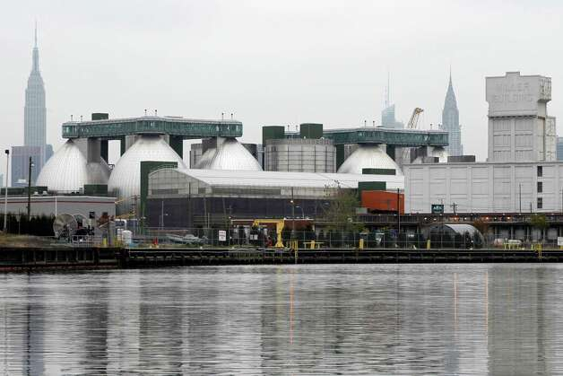 This Oct. 24, 2012 photo shows one of New York's 14 wastewater treatment plants, they city's biggest and newest, on Newtown Creek. During heavy rainstorms, when the treatment plants reach capacity, raw sewage and wet garbage spill into the creek thorough hundreds of pipes on its banks. (AP Photo/Mary Altaffer) Photo: Mary Altaffer
