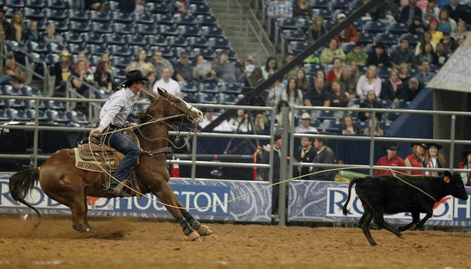 EJ Roberts competes in the Tie_Down Roping in the Super Series II rodeo competition at Reliant