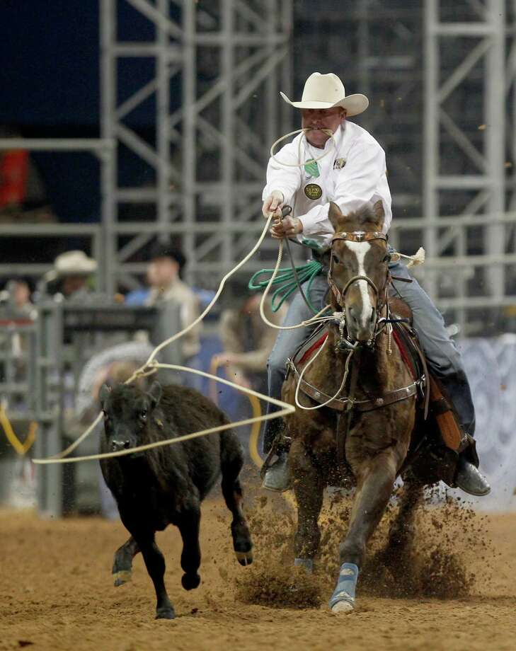Trent Creager competes in the Tie_Down Roping in the Super Series II rodeo competition at Reliant Stadium in Houston, Texas. Photo: Thomas B. Shea, For The Chronicle / © 2012 Thomas B. Shea