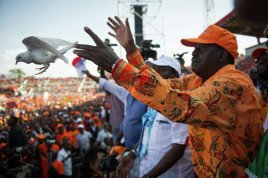 Kenyan Prime Minister and presidential candidate Raila Odinga releases a dove at a rally in Nyayo Stadium in Nairobi on the last day of campaigning, 48 hours ahead of presidential, gubernatorial and senatorial elections Monday. Photo: Phil Moore / AFP / Getty Images